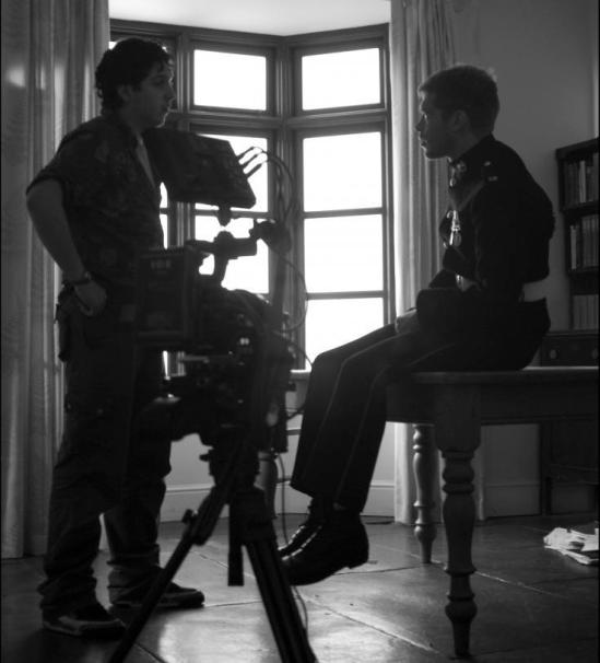 Luke Massey and Joseph Morgan on the set of Warhouse
