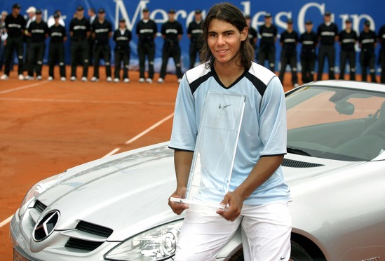 Rafael Nadal of Spain poses with his tro
